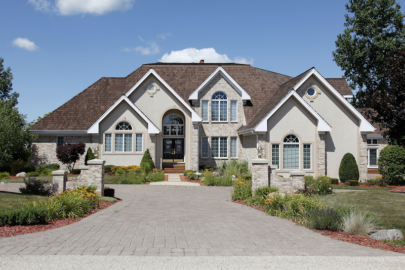 Luxury home in suburbs with stone pillars
